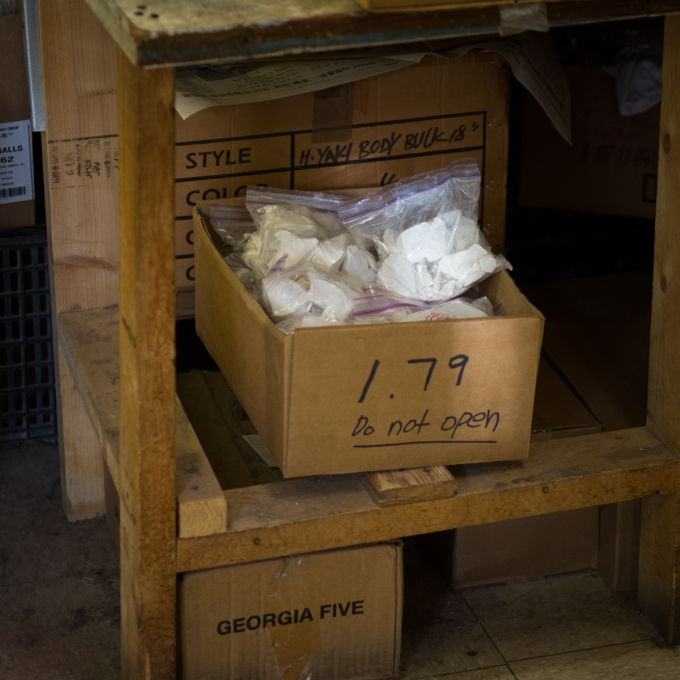 A box of packaged white dirt on sale at MLK Market in Greensboro, Ga.