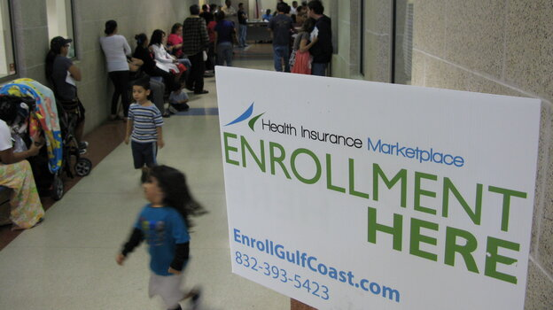 People wait in hallways for help enrolling in insurance at a city service center in southwest Houston on Monday.