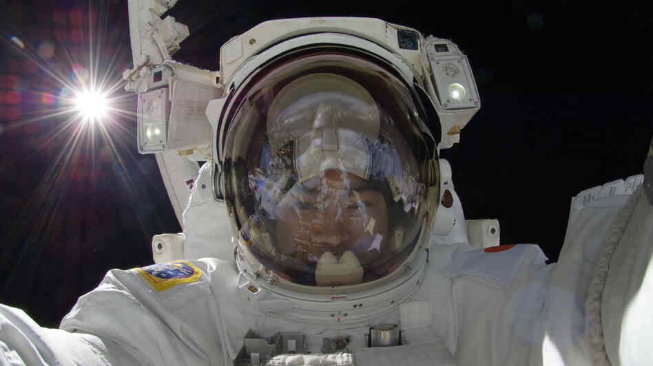 Japan Aerospace Exploration Agency astronaut Aki Hoshide makes a space walk outside the International Space Station in 2012.