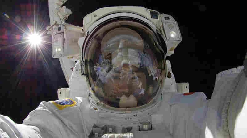 Japan Aerospace Exploration Agency astronaut Aki Hoshide makes a space walk outside the International Space Station in 2012.