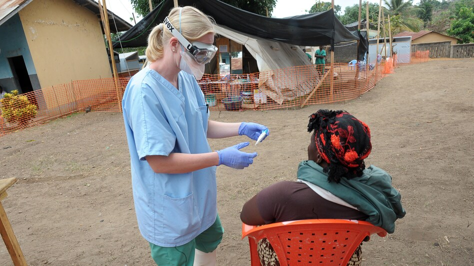 A Nurse Of The Doctors Without Borders Medical Aid Organisation Examines Patient In