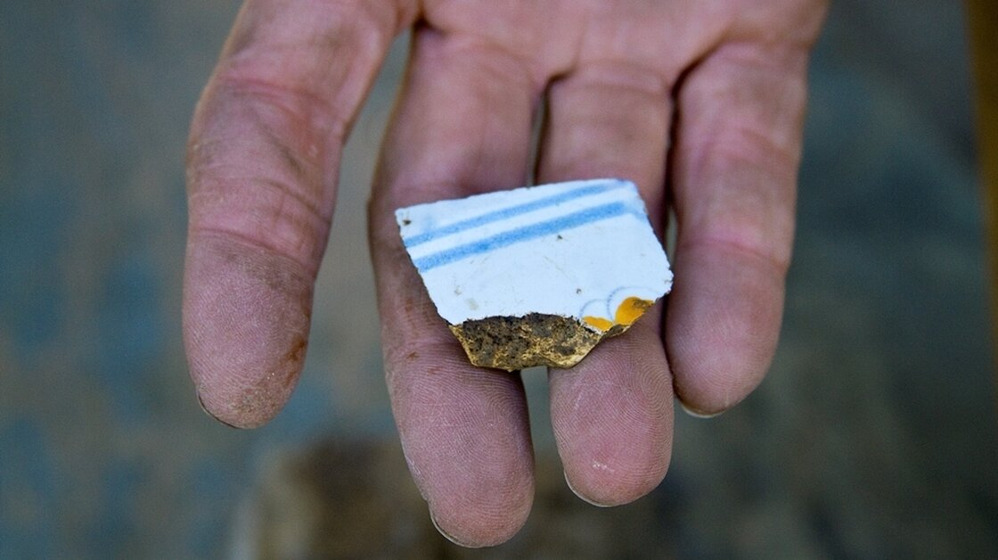 A piece of tin-enameled ceramic found at what archaeologists say is the site of a former French colony in St. Louis.