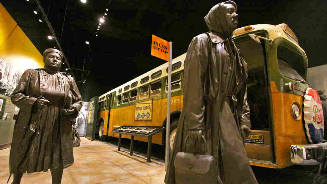 The Montgomery Bus Boycott exhibit at the National Civil Rights Museum features a vintage city bus. Visitors can go inside the bus and sit next to a figure of Rosa Parks.