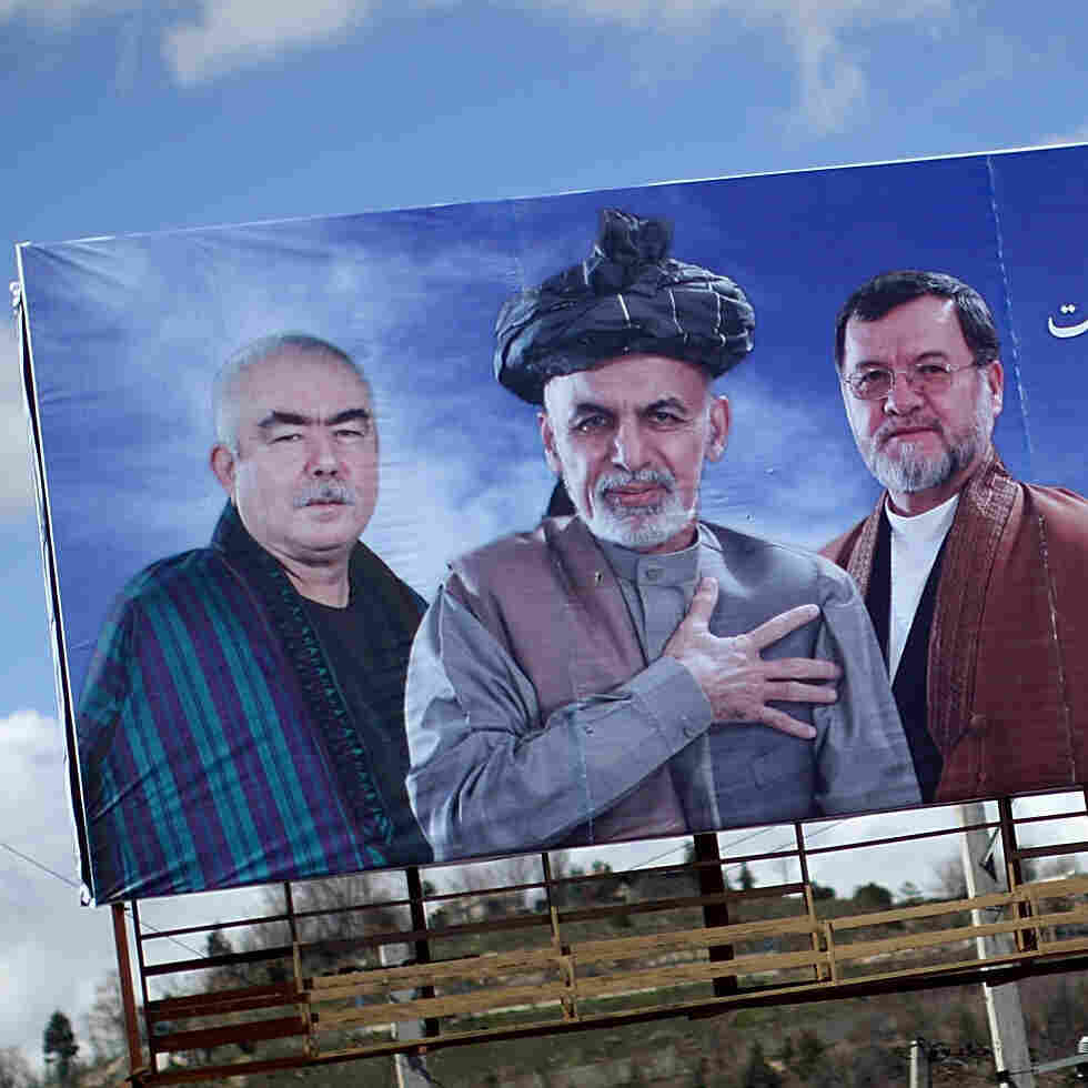 A man walks past a billboard for presidential candidate Ashraf Ghani in the Afghan capital Kabul. President Hamid Karzai is stepping down and the country is poised for its first-ever democratic transition of power. The ballot is set for Saturday.