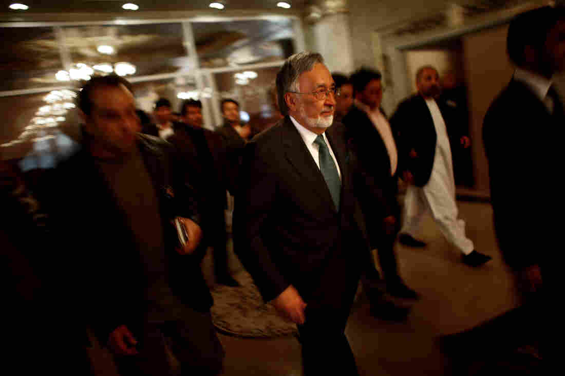 Dr. Zalmay Rassoul walks through the lobby of the Intercontinental Hotel in Kabul during a campaign event. Rassoul is a former foreign minister and is one of leading candidates.