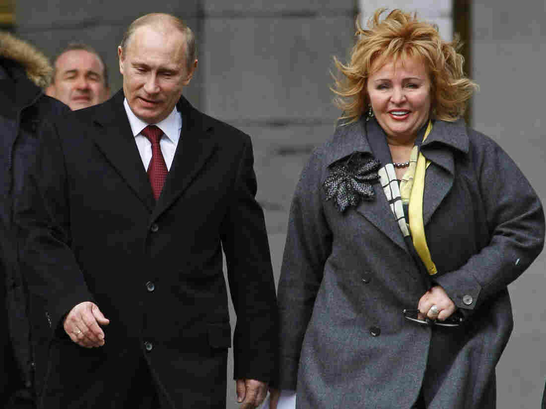 Vladimir Putin and Lyudmila arrive at a polling station in Moscow, Russia, in a March 2012 photo.