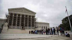 People wait in line for the beginning of the 2013-2014 Supreme Court term in Washington on Oct. 7. The court heard the first major case on campaign contribution limits since 2010's landmark Citizens United.