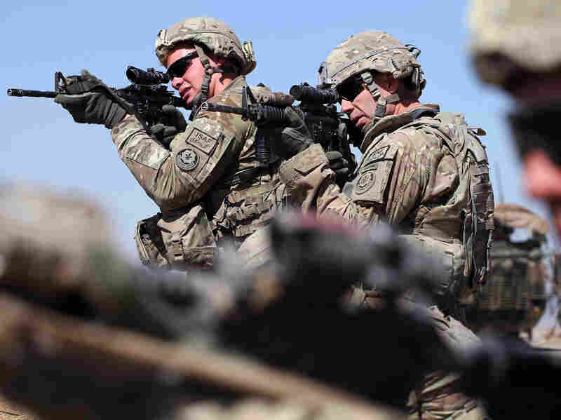 U.S. soldiers look for enemy movement during a joint patrol with soldiers from the Afghan National Army on March 1, near Kandahar, Afghanistan.