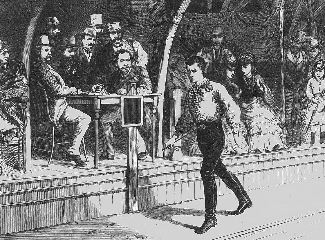 """Walking The Walk: Fans look on as pedestrian Edward Payson Weston walks at a New York City roller rink in 1874. His unique stride was described as """"wobbly."""""""
