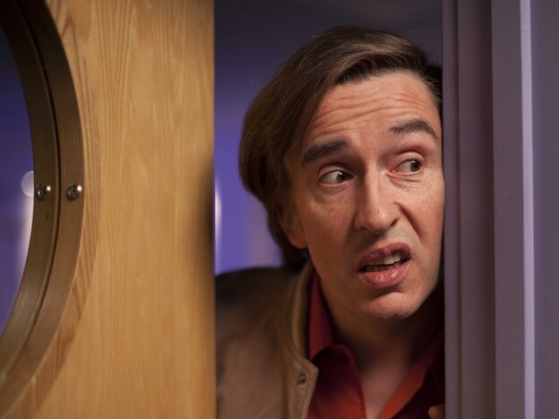 Steve Coogan brings his Alan Partridge character — a conceited, petty, utterly inept broadcast blowhard who once killed a guest on live TV — to the big screen in <em>Alan Partridge</em>.