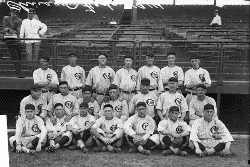 Members of the Whales baseball team gather in front of grandstands at Weeghman Park in 1914. The park was renamed by the gum magnates in 1927.