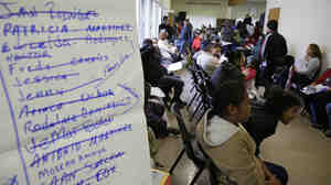 Last-minute applicants for health insurance jam the Bay Area Rescue Mission in Richmond, Calif., on Monday.