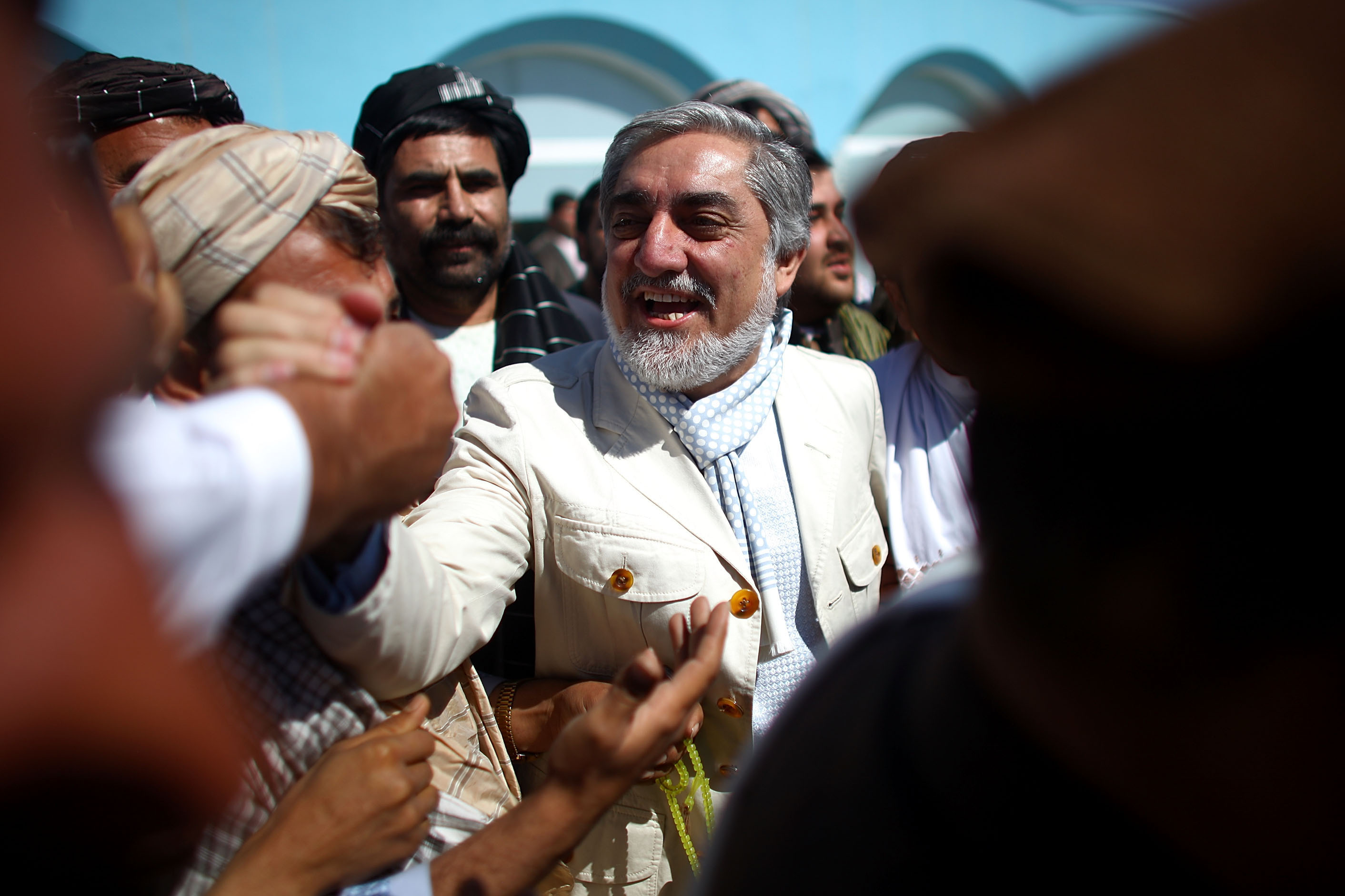 Presidential candidate Dr. Abdullah Abdullah is greeted by well-wishers and local officials at Kandahar International Airport. He held a rally in the southern city in an effort to improve his standing among Pashtuns, who dominate the region.