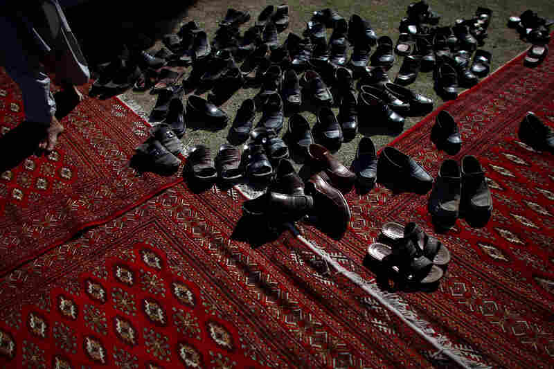 The shoes of guests visiting Abdullah at a private reception. He is an ophthalmologist who served as foreign minister in President Hamid Karzai's government from 2001-2005, and was Karzai's main challenger in the 2009 election.