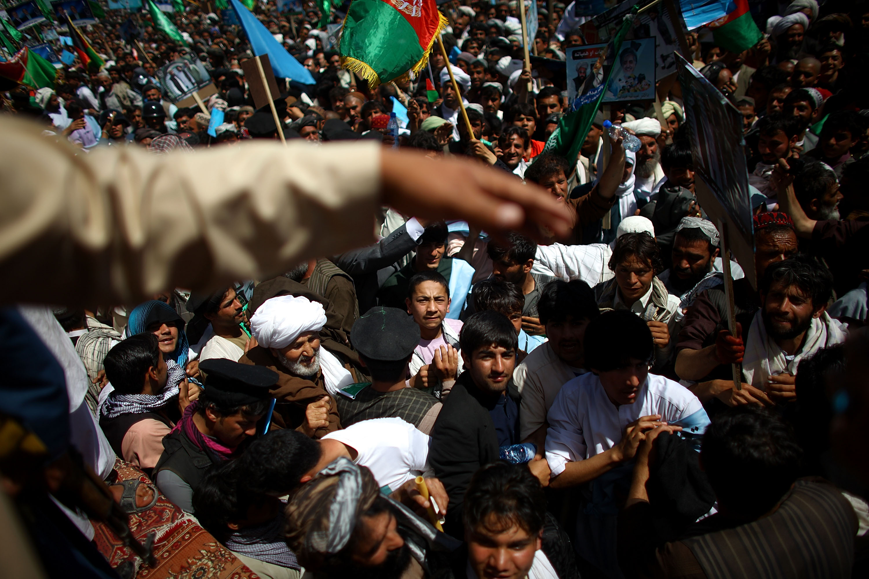 Crowds surge toward the stage during a speech by Abdullah at a stadium in Kandahar as part of a campaign stop.