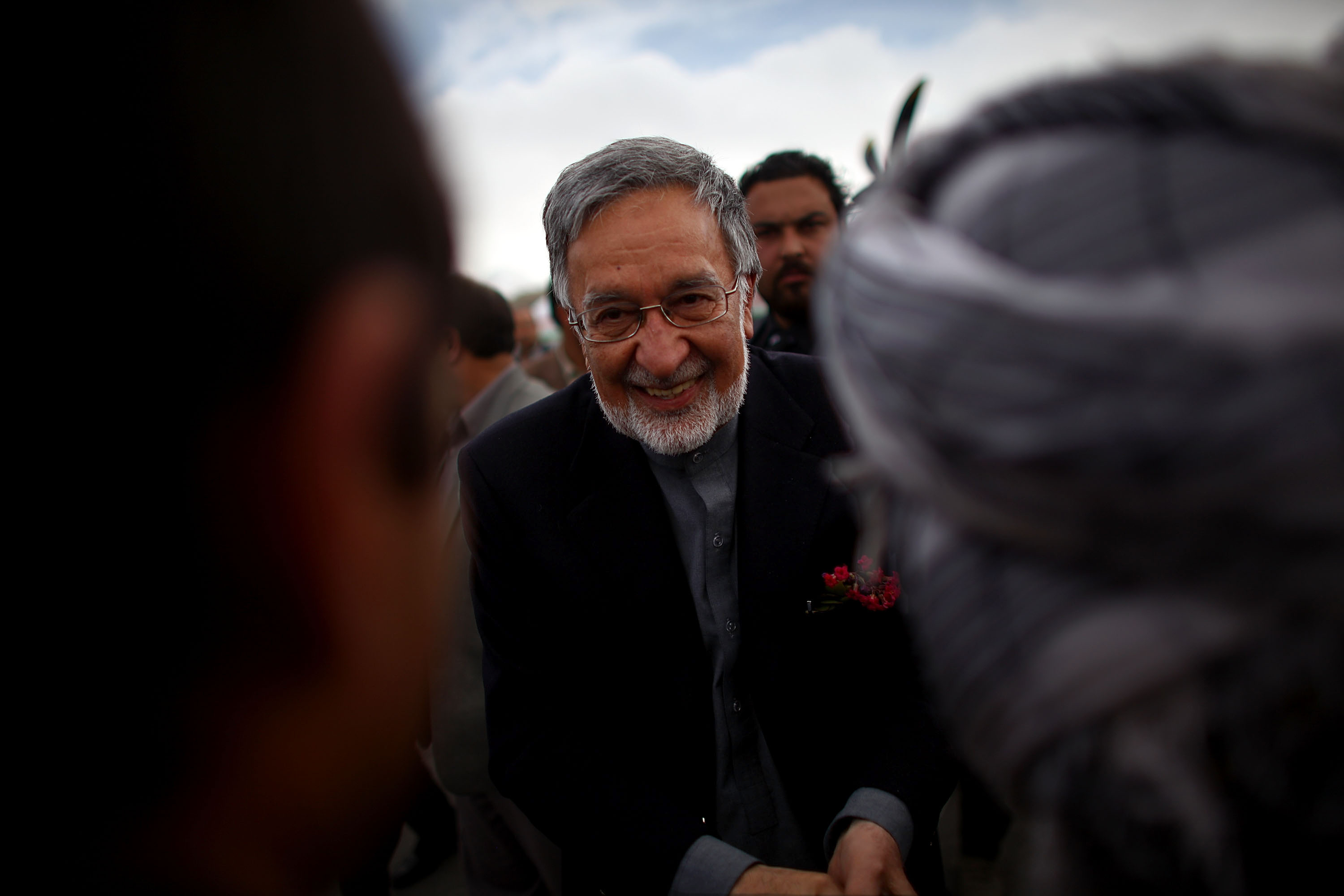 Presidential candidate Zalmay Rassoul shakes hands and greats well-wishers at the Bamiyan airport before a campaign rally. He has served in several top posts, including foreign minister, national security adviser and minister of civil aviation.