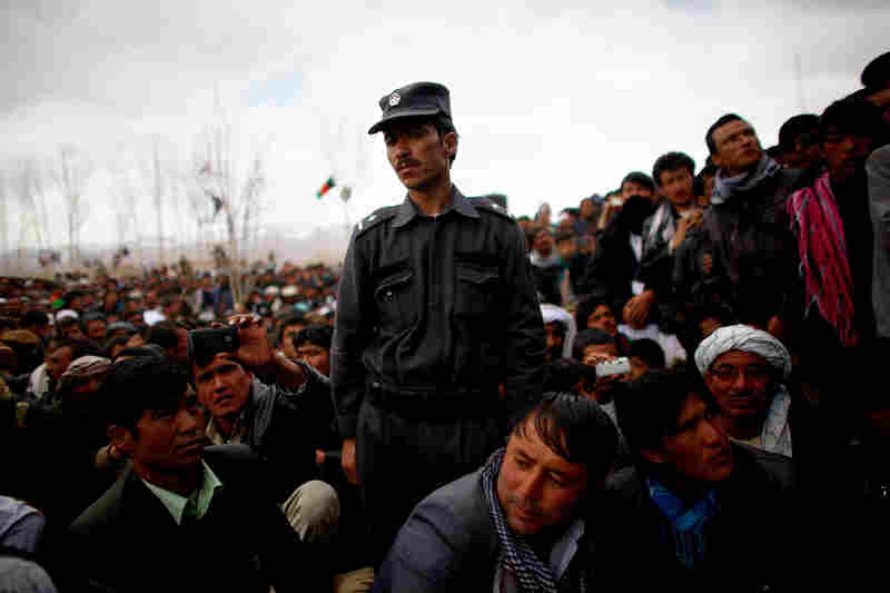 Security forces stand guard at a rally for Rassoul in Bamiyan. The soft-spoken politician is widely viewed as Karzai's choice as a successor, though Karzai has not endorsed any candidate.