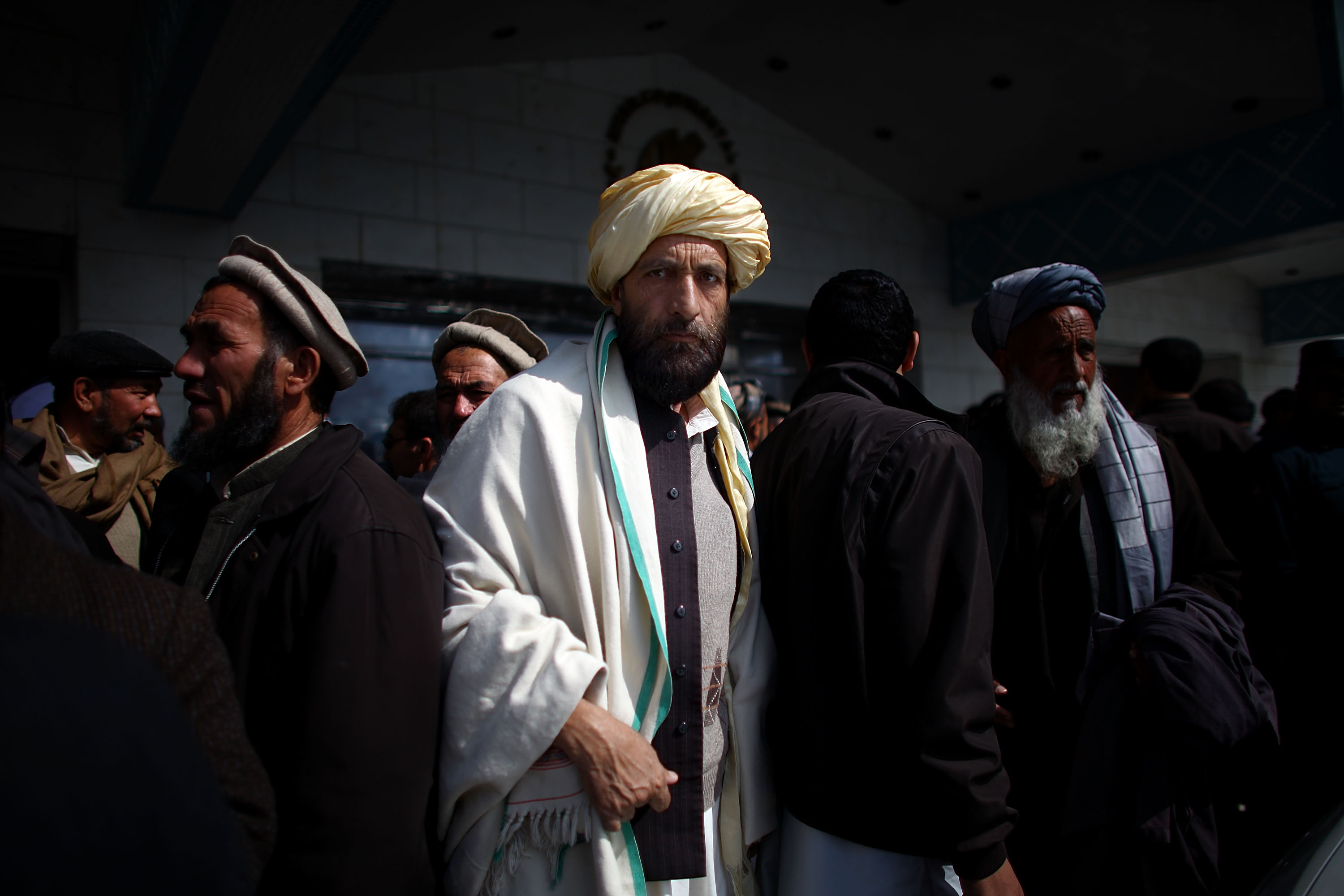 A man walks out of the ballroom of the Intercontinental Hotel in Kabul after an election meeting with Rassoul. Local officials and tribal leaders attended the function to support his campaign.