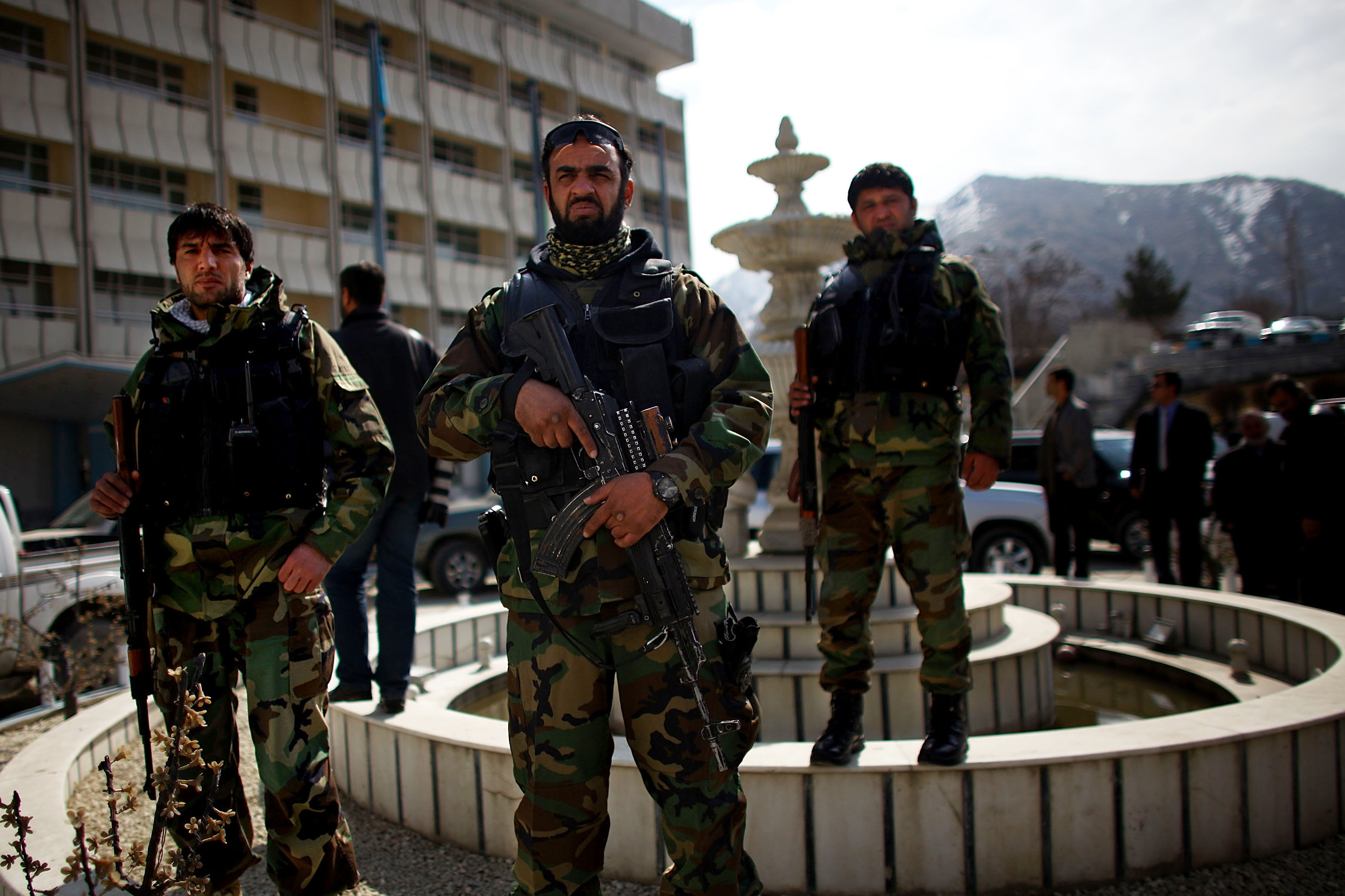 Afghan National Security Forces stand guard outside of the hotel in Kabul during the campaign event for Rassoul.