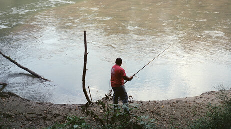 Frank Cedillo fishes in a Greeneville, Tenn., lake.