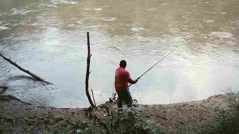 Frank Cedillo fishes in a Greeneville, Tenn., lake.