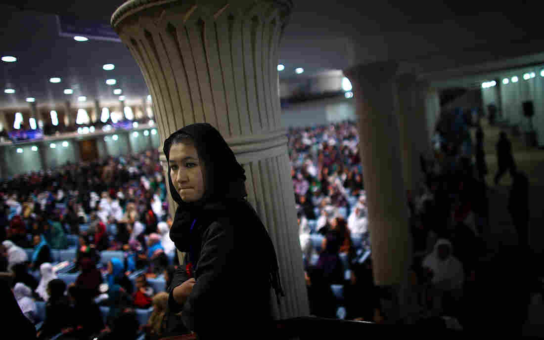 An Afghan woman listens to presidential candidate Ashraf Ghani during a campaign rally in Kabul on March 9, International Women's Day. Women will play a greater role in choosing Afghanistan's next president than ever before.