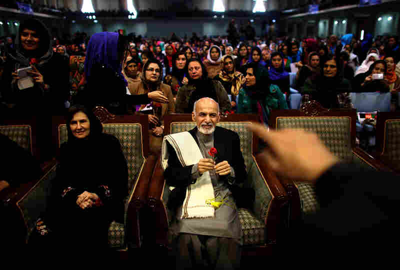 Ghani sits next to his wife, Rula, during a campaign rally in Kabul on March 9. In an unusual move for Afghan politics, Ghani's wife spoke during the rally.