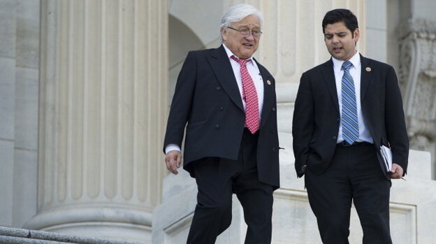 Rep. Mike Honda (left) walks down the House steps with Rep. Raul Ruiz after a vote at the Capitol on March 20, 2013.