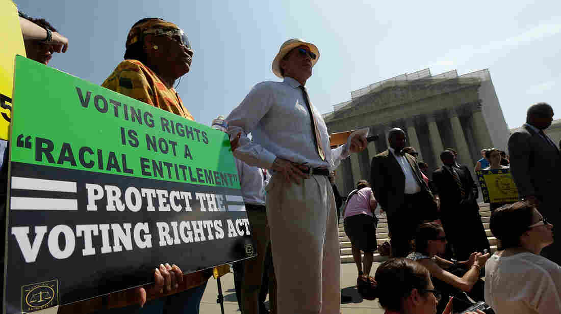 Supporters of the Voting Rights Act listen to speakers discussing the Supreme Court's rulings outside the court building in June 2013. The court ruled that Section 4 of the Voting Rights Act, aimed at protecting minority voters, is unconstitutional.