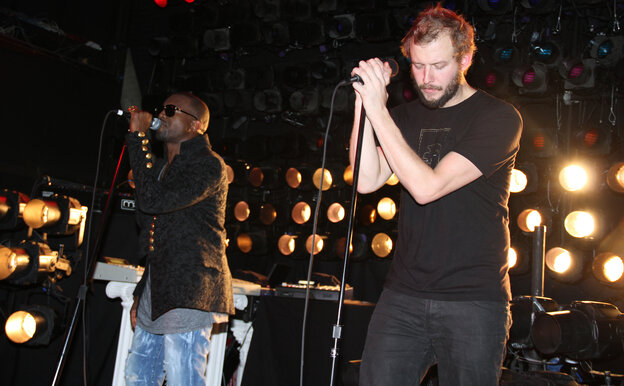 These guys can get along. Why can't we? Kanye West (left) and Justin Vernon in 2010.