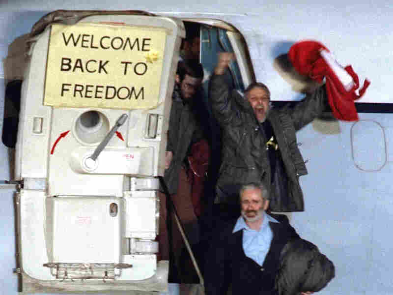 David Roeder shouts and waves as he and others arrive in Frankfurt, West Germany, on Jan. 21, 1981. He was among the 52 hostages. Roeder adamantly opposes Aboutalebi's nomination.