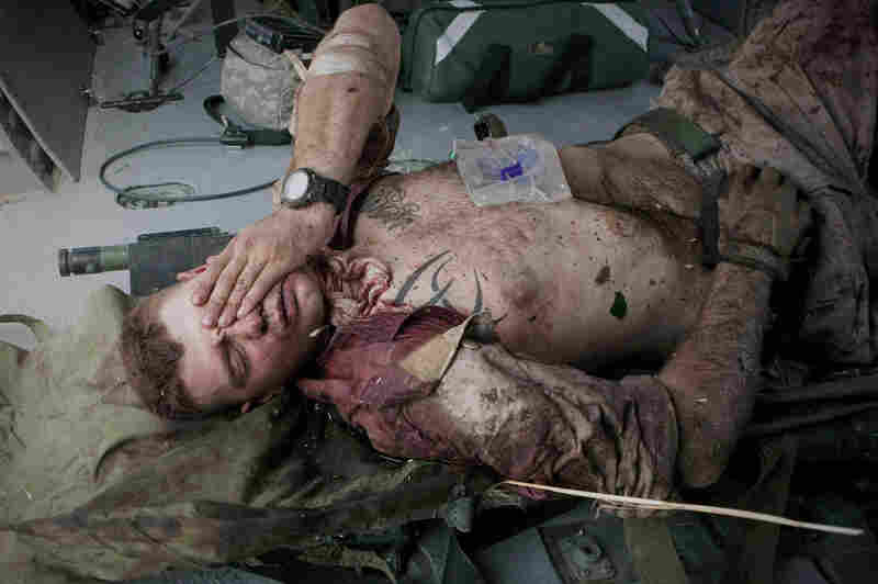 Injured U.S. Marine Cpl. Burness Britt reacts after being lifted onto a medevac helicopter in 2011.