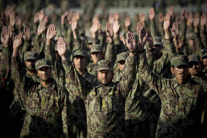 Afghan army soldiers participate in morning exercises at a training facility on the outskirts of Kabul in November 2013.