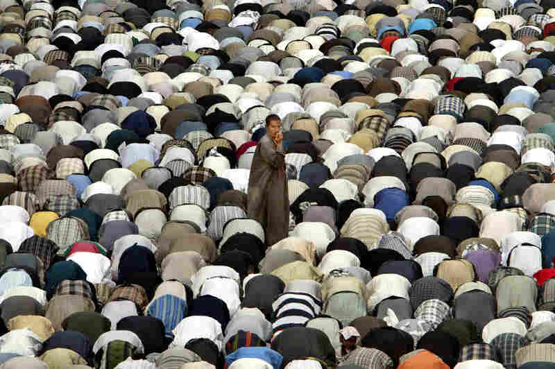 An Iraqi Shiite Muslim stands among others during Friday prayers in Baghdad's Shiite shrine in Kazemiya in 2003.