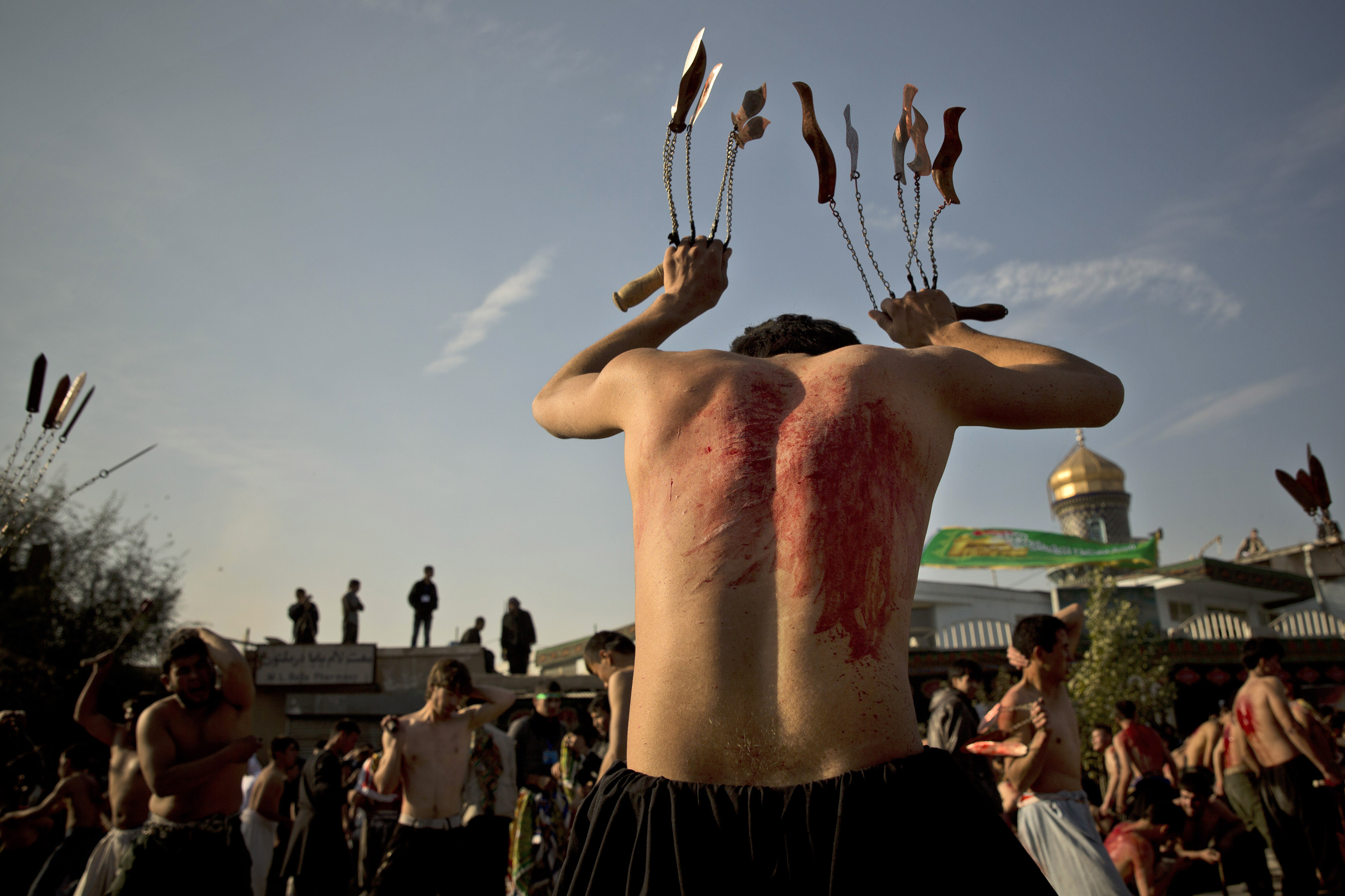Afghan Shiites beat themselves with chains and blades in a ritual ahead of the Ashura holiday outside the Abul Fazel Shrine in Kabul in November 2013.