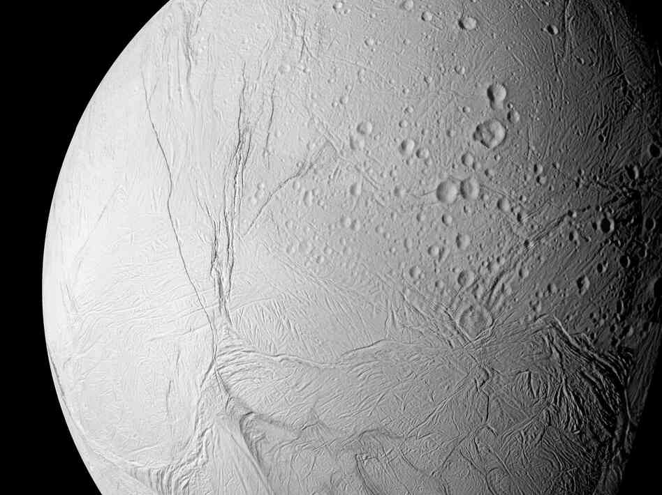 A photo released by NASA in 2006 shows the surface of Saturn's moon Enceladus as seen from the Cassini spacecraft.