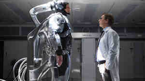 Joel Kinnaman (left) as Alex Murphy and Gary Oldman as Dr. Dennett Norton in Robocop.