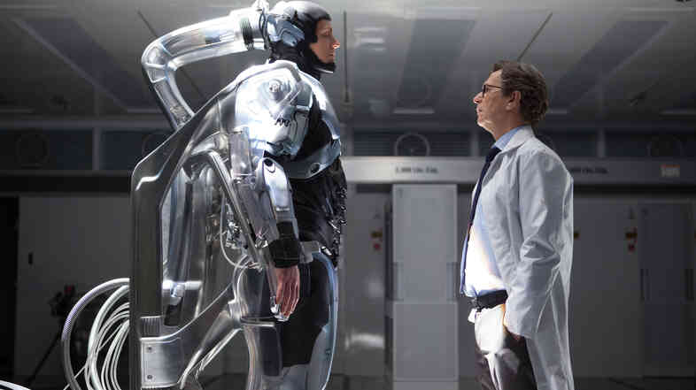 Joel Kinnaman (left) as Alex Murphy and Gary Oldman as Dr. Dennett Norton in Robocop.