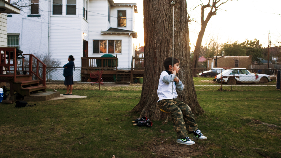 Eight-year-old Francis Csedrik pauses mid-swing in his backyard in Washington, D.C. Like most kids, he's gradually losing his memories of things that happened when he was 3 years old. (NPR)