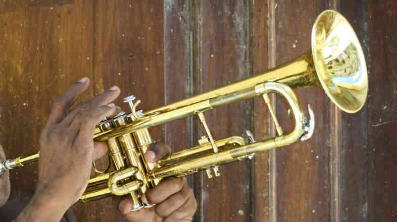 A musician plays the trumpet