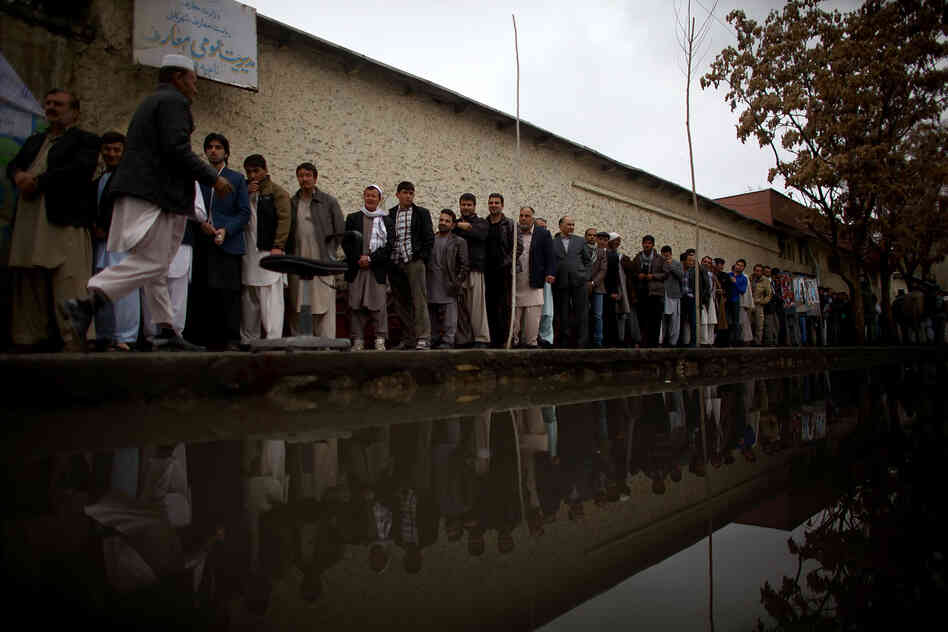 Long lines were seen at almost every polling station around Kabul Saturday, despite heavy rain and security threats. Afghans are voting for a new president along with provincial candidates in what will be the nation's first transfer of power through an election process.
