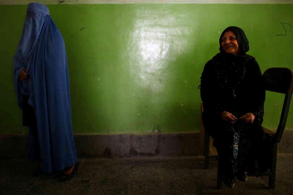 Women wait their turn to vote.