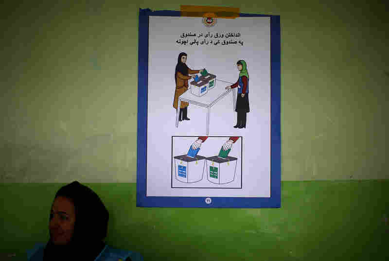 An election poster explains Afghanistan's voting procedures.