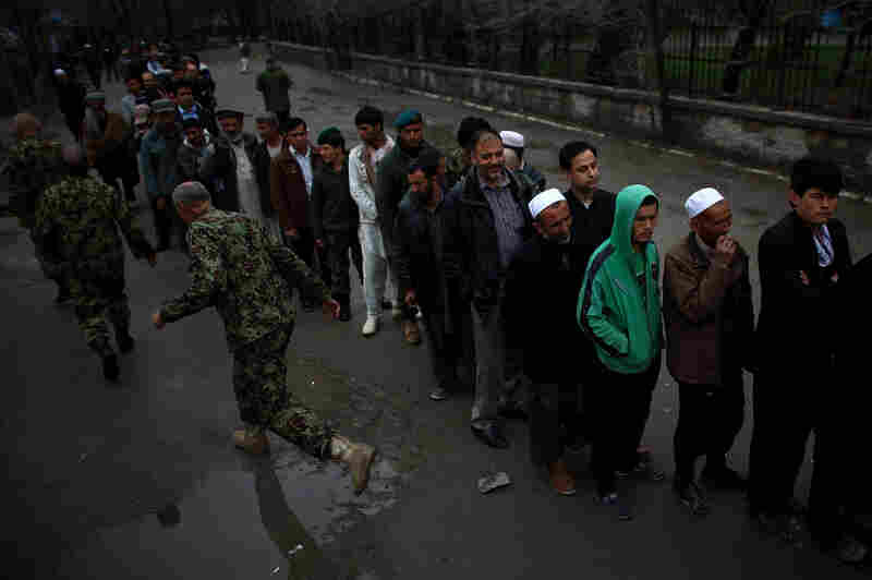 Despite heavy rains, the turnout was brisk with long lines for both men and women at may voting stations.
