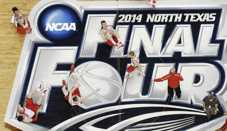 The NCAA Final Four gets underway at 6:09 p.m. ET Saturday, as the men's college basketball tournament heads toward its conclusion with Monday night's championship game. Here, Wisconsin players exercise on the court.