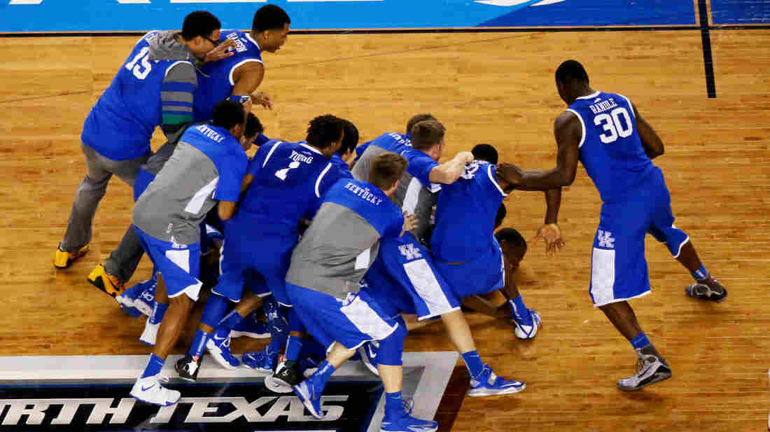 The Kentucky Wildcats celebrate after defeating the Wisconsin Badgers 74-73 in the NCAA Men's Final Four.