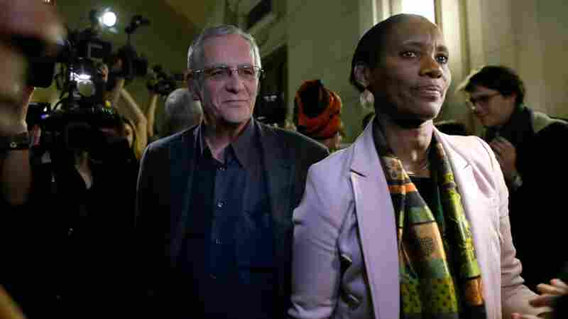 Dafroza Gauthier and her husband, Alain, leave the Paris courthouse on March 14, after former Rwandan intelligence chief Pascal Simbikangwa was sentenced for complicity in genocide and crimes against humanity.