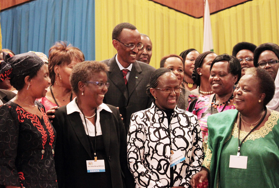 Rwandan President Paul Kagame (center) takes part in a group photo at a conference on the role of women at the nation's parliament in Kigali, Rwanda, in 2010.