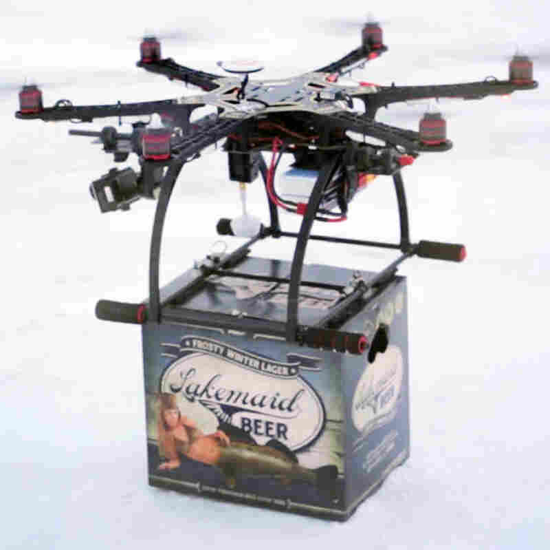 A mini-drone lands with a 12-pack of beer for ice fishing anglers in Minnesota in January. The Federal Aviation Administration grounded future deliveries when they learned of the service.