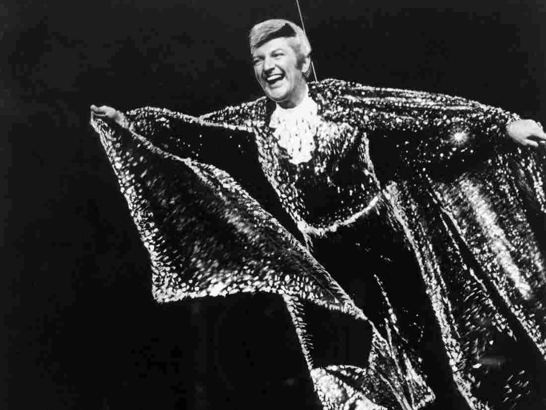 Liberace flies over the stage in the grand finale of a Las Vegas performance in 1974.